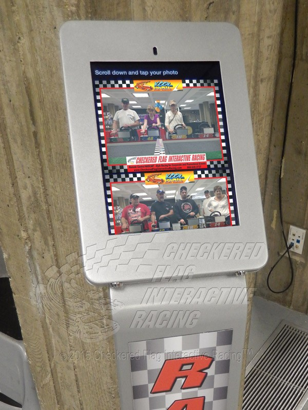 Close-up of kiosk displaying race images.