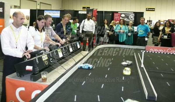 Checkered Flag Interactive Racing entertaining in a trade show booth